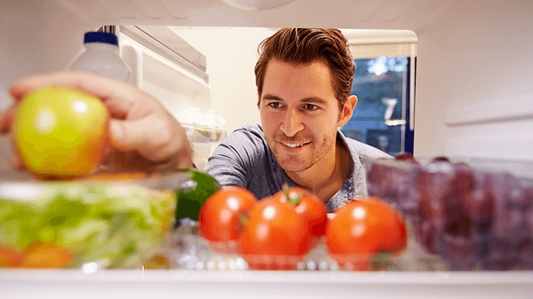 man-arranging-food-in-fridge-1