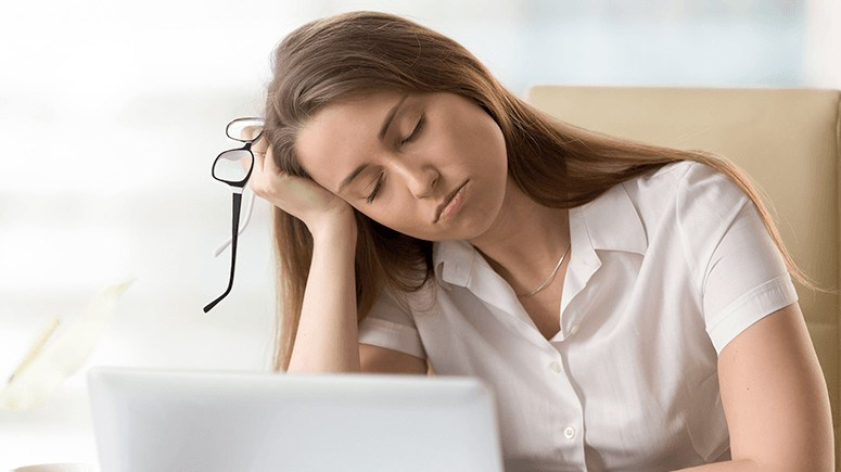 woman-tired-at-desk-3